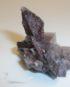 A complex specimen of smoky quartz, fluorite, and specular hematite